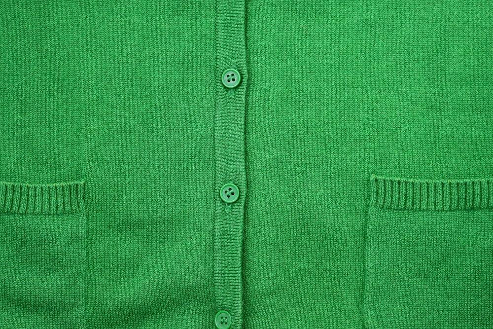 グリーンのニット